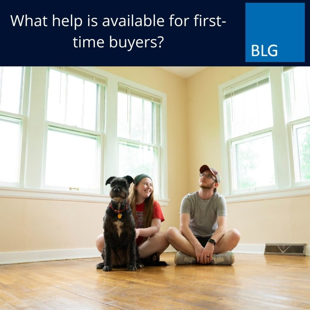 What help is available for first time buyers graphic with couple and dog in new home image